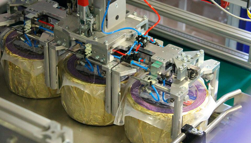 Automatiseret-ostepakkeri